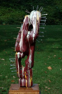 "Pain Of War, Bass wood, paint, glitter, nails, shell casins, 44""h"